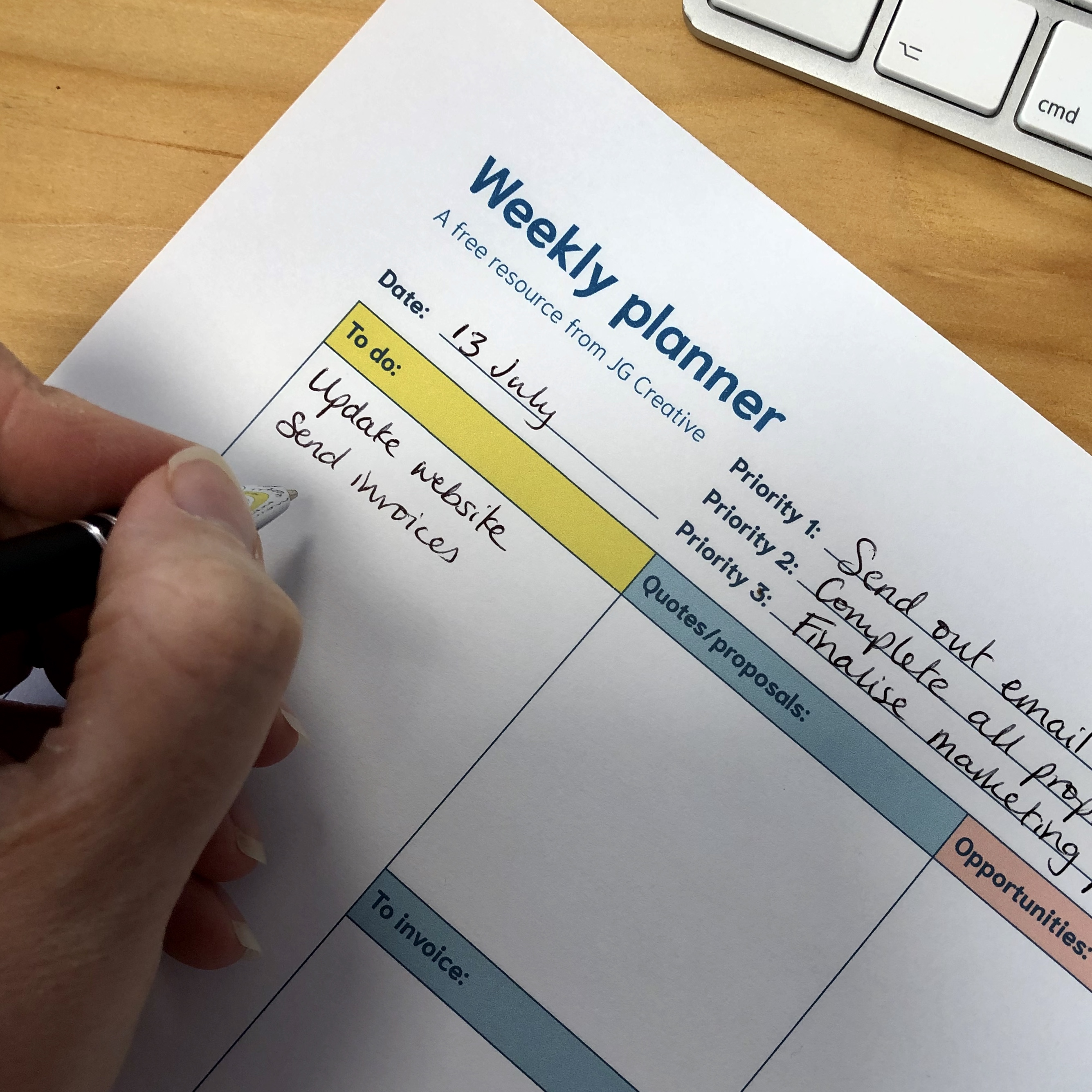 Image of a hand writing into the Weekly planner