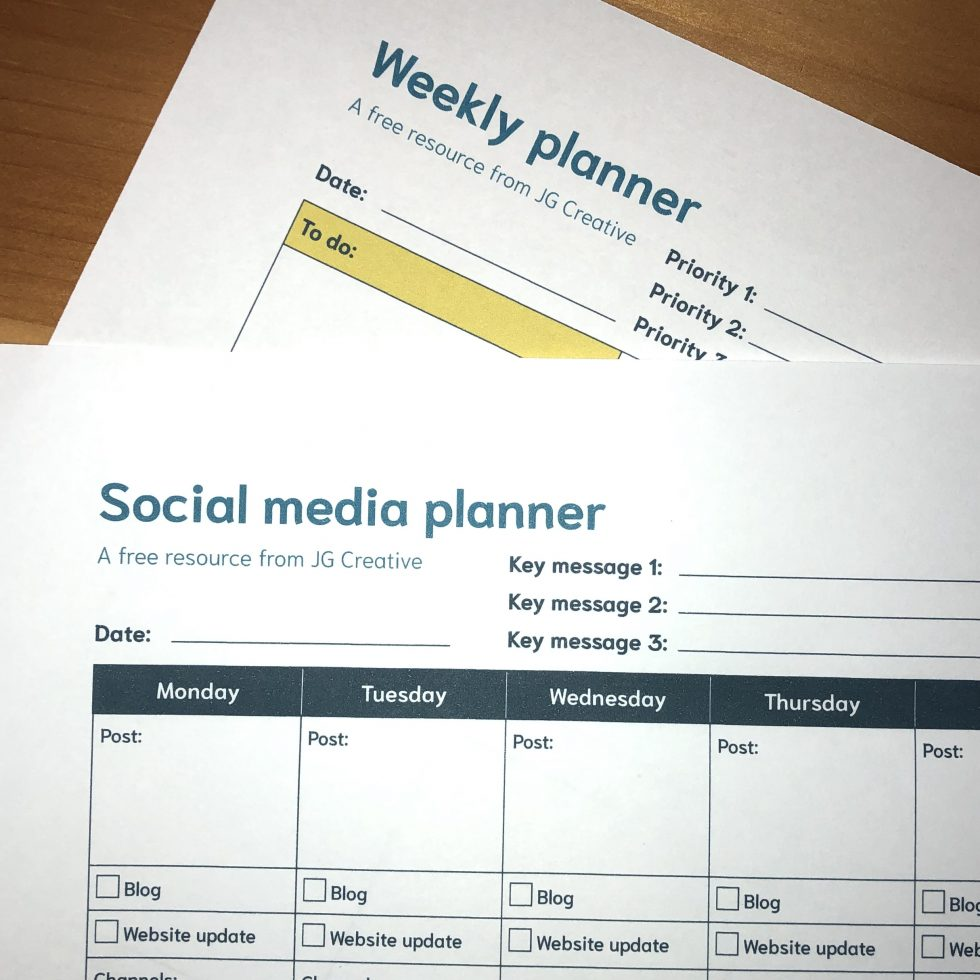 A photograph of the Weekly planner and Social medial planner on a desk.